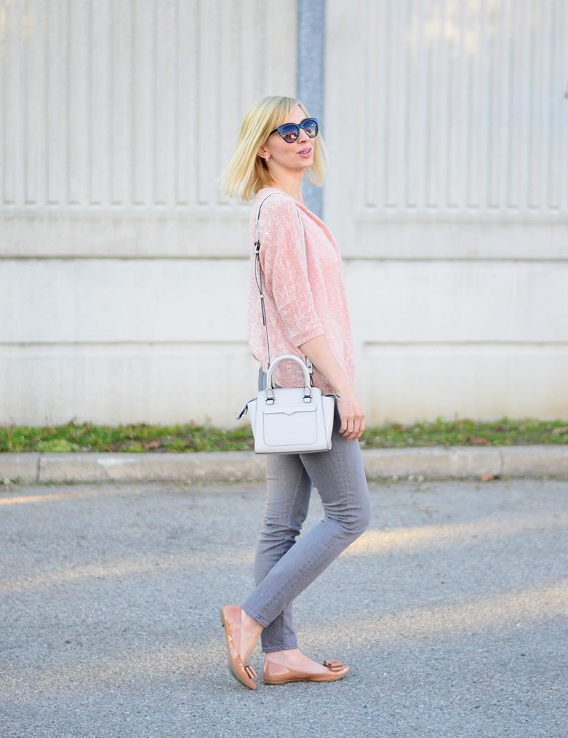 pink cardigan and grey jeans
